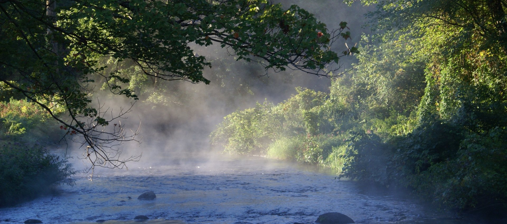 Image of steam rising off the Nubanusit River on a fall morning, Peterborough NH