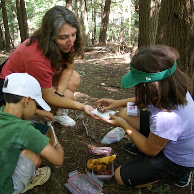 Image of geocachers finding a cache