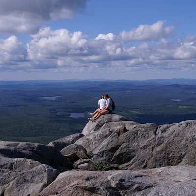 Image of hikers resting at the top of Mount Monadnock