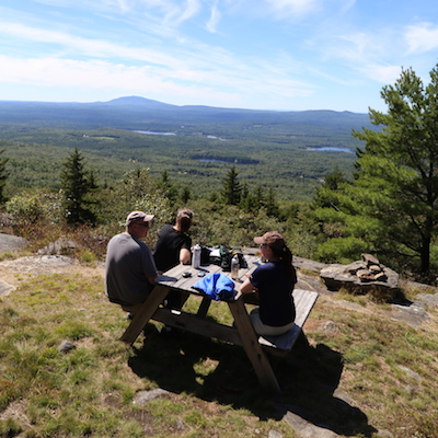 Image of hikers enjoying views from Crotched Mountain