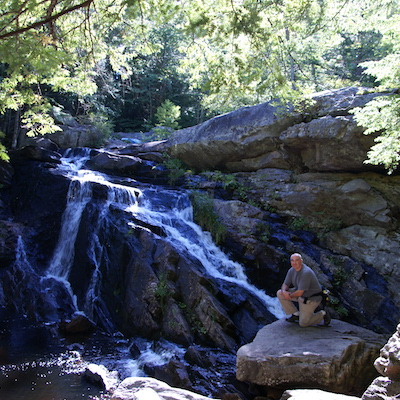 This is an image of people enjoying Lower Purgatory Falls, Wilton NH